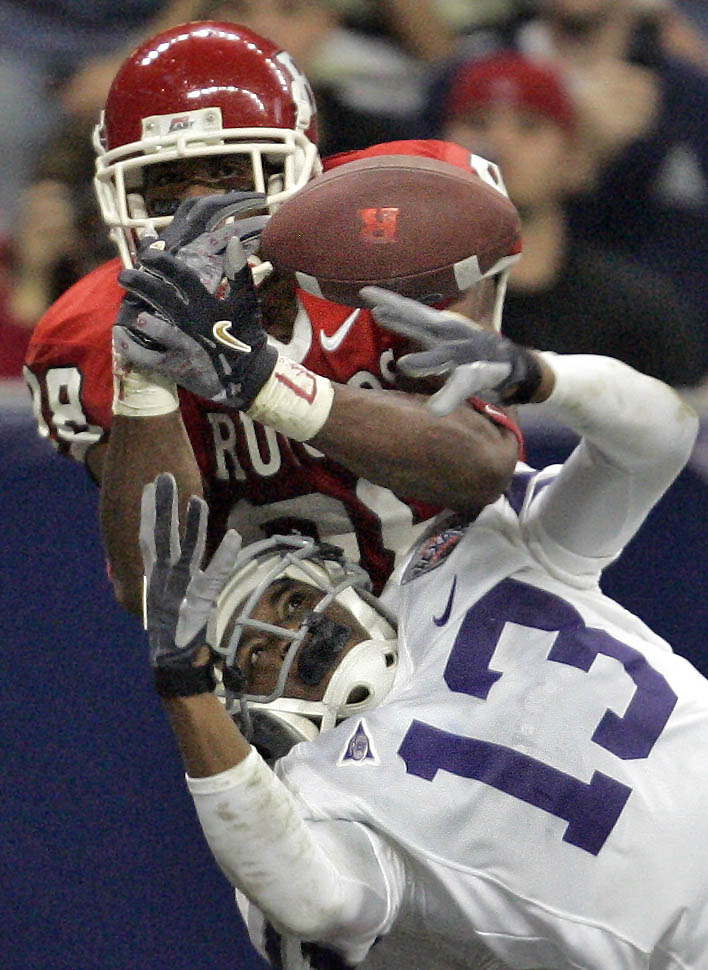 Joshua Moore of Kansas State deflects a possible a touchdown reception from Kenny Britt (top) of Rutgers in the Texas Bowl