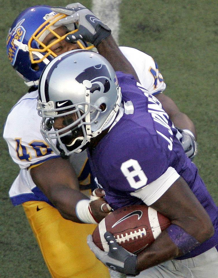 James Johnson of Kansas State runs through Demetrius Jones of San Jose State.