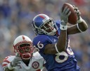 Marcus Henry of Kansas completes a 42 yard pass reception against Andre Jones (left) of Nebraska.