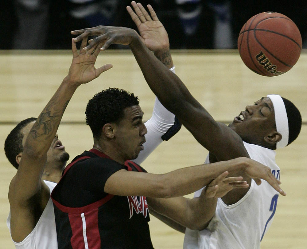 Tremaine Townsend of Northridge (center) is surrounded by Memphis teammates Shawn Taggart (left to right) Robert Dozier during the NCAA Tournament.