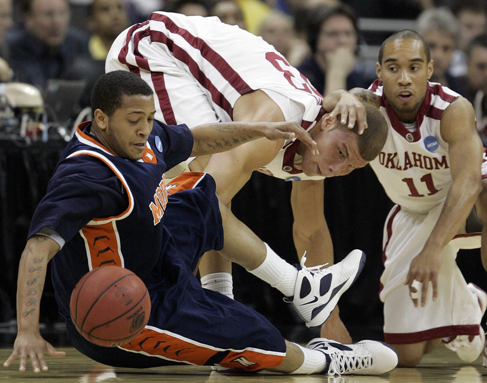 Jermaine {quote}Itchy{quote} Bolden (left) Morgan State tries to keep the ball away from Oklahoma teammates Blake Griffin (center) and Omar Leary during the NCAA Tournament.