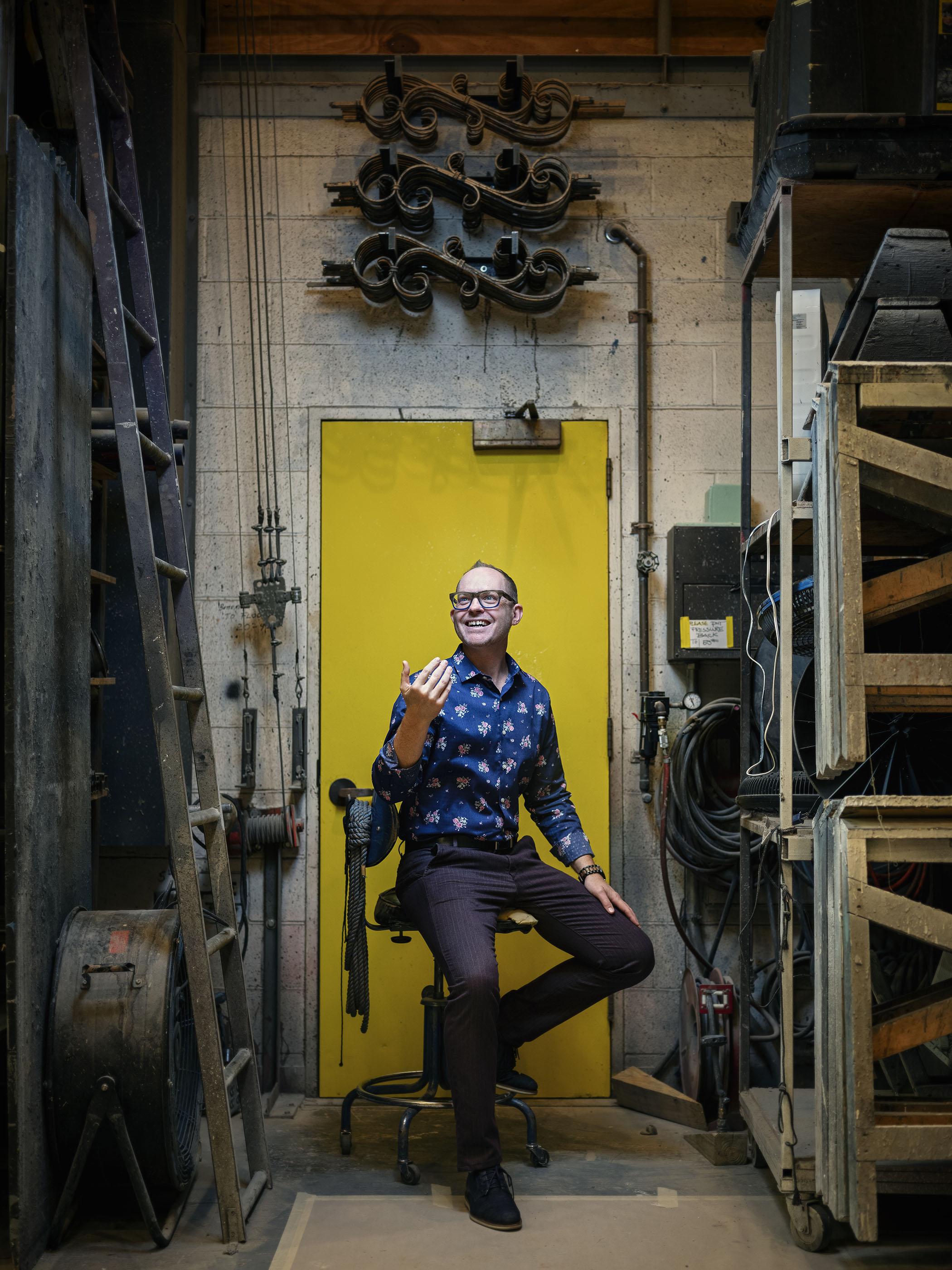 Portrait of Stuart Carden, KC Rep's new artistic director sitting inside the Rep's scene shop.