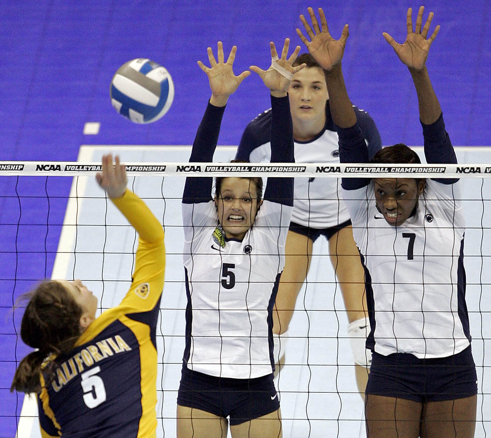 Adrienne Gehan (left) of California goes up for a kill against Penn State teammates Kristen Carpenter (5) and Arielle Wilson (7) during the NCAA National Championship.
