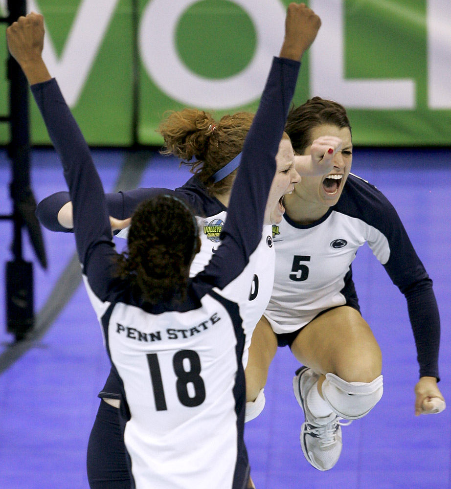 Penn State played against California in the NCAA Women's Volleyball Championship in Kansas City. Penn State teammates Deja McClendon (left to right) Katie Slay and Kristen Carpenter celebrate after winning the championship.