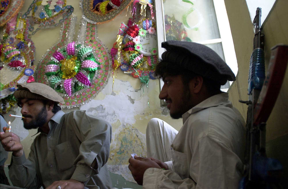 Soldiers of Afghanistan warlord Kamal Khan occupy and hide inside the governor's mansion in Khost, Afghanistan. warlords