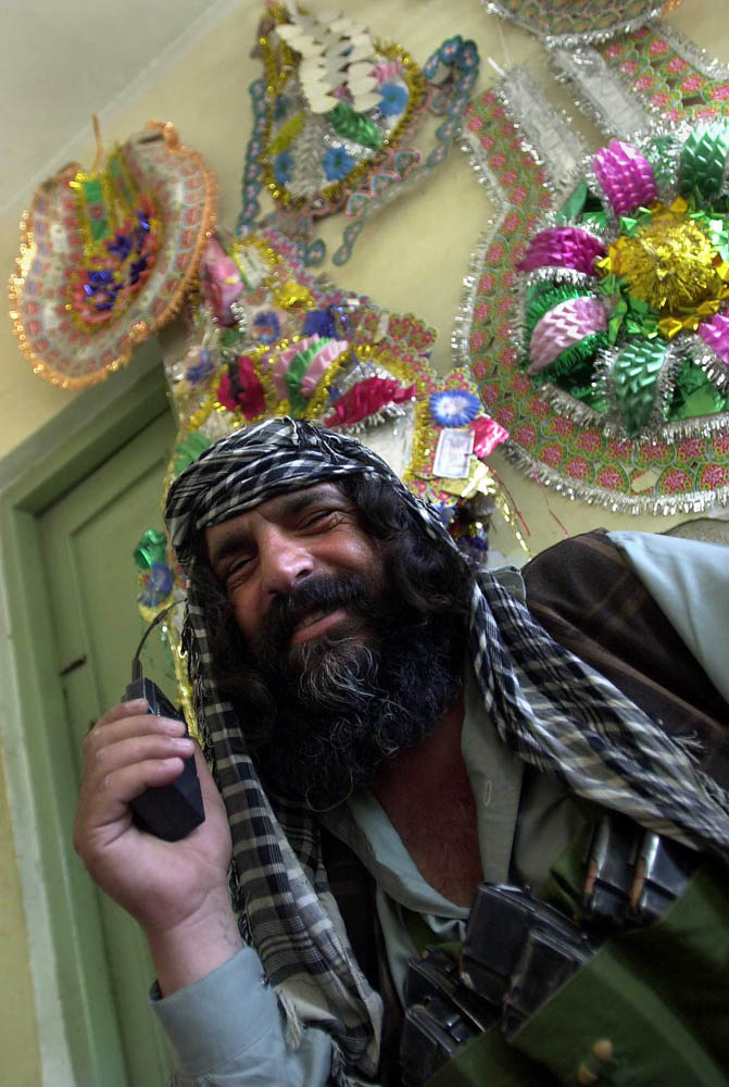 Zanghul Pacha, a commander for Khost, Afghanistan warlord Kamal Khan who occupies the governor's mansion, hams it up for the camera.