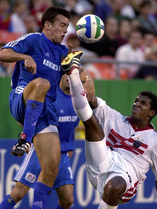 Kerry Zavagnin (left) of the Kansas City Wizards nearly took a kick to the face from Carlos Llamosa of D.C. United.