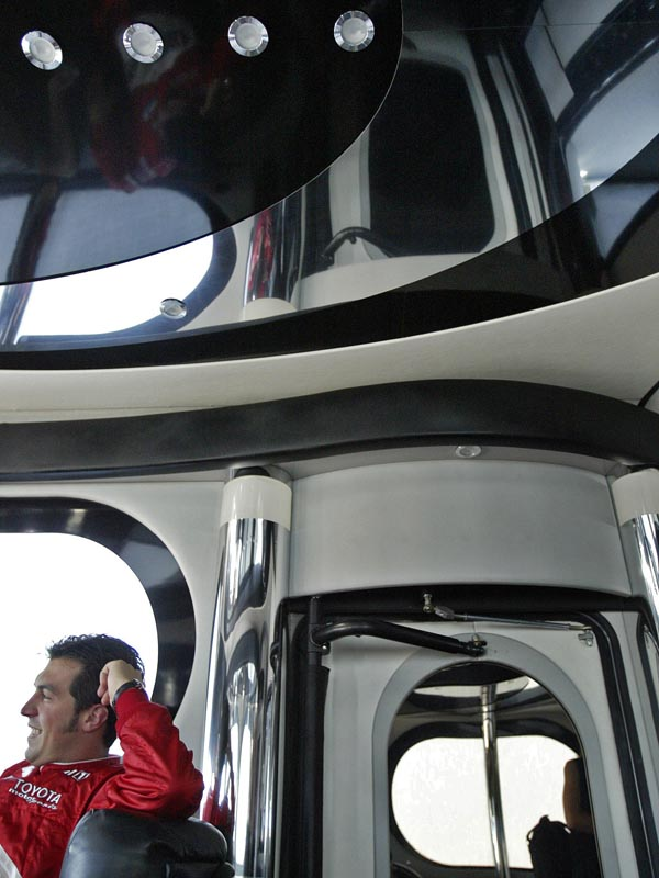 IRL driver Sam Hornish Jr. relaxes inside his team bus at The Kansas Speedway.