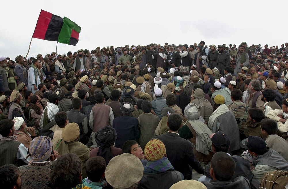 A few thousand Afghans surrounded resigned province mayor, Mullah Taj Mohammad as he tries to rally them for their support of province representative in Afghanistan's Loya Jirga.