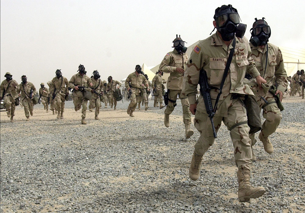Soldiers of the 82nd Airborne run for skud bunkers at Champion Main Kuwait during a missile attack in Operation Iraqi Freedom.