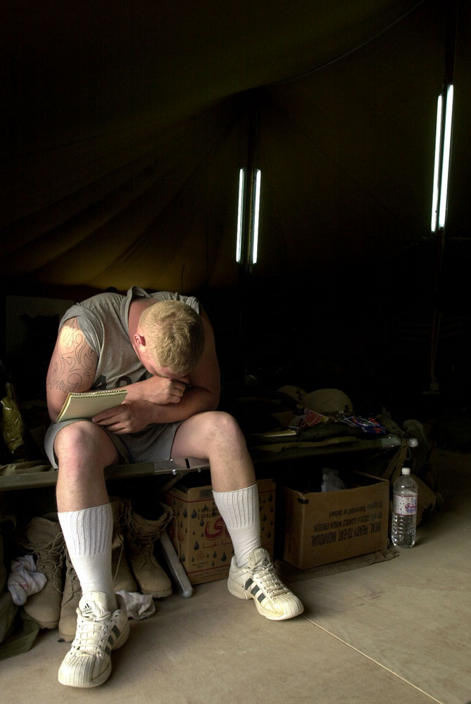 Spc. Brad Hall pauses to find words as he writes a letter home to his fiancee from Kuwait. {quote}I've been waiting for her third letter{quote} adding {quote}it must be stuck somewhere.{quote}