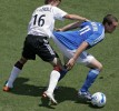 Brian Carroll (left) of D.C. United holds onto Kurt Morsink of the Kansas City Wizards.