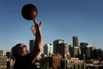 Denver Nuggets head coach, George Karl poses for a portrait with the downtown Denver, Colo. cityscape in the background.  The former player and longtime head coach is trying to improve on his team's performance last year that included a playoff appearance.  Photo by Matt McClain