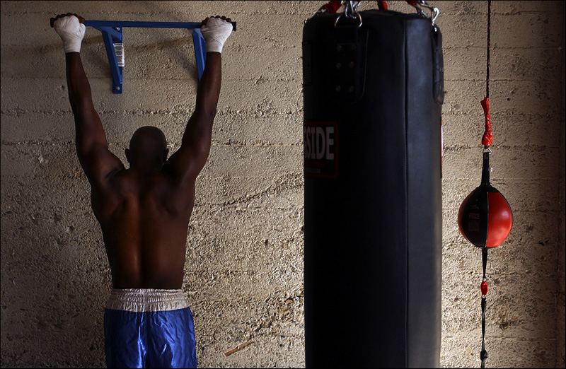 Israel Spencer of Naval Base Ventura County stretches during a workout at Sylvia's Boxing Gym on Main Street in Ventura.  Photo by Matt McClain