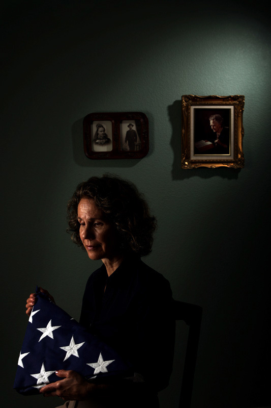 The widow of Medal of Honor recipient and Vietnam War casualty, Jon E. Swanson, Sandee Swanson (cq) holds the folded American flag presented to her as she poses for a portrait Monday 09/15/08 at her family's Westminster, Colo. home.  Swanson got remarried to Jon's younger brother, Tom Swanson.  Photo by Matt McClain