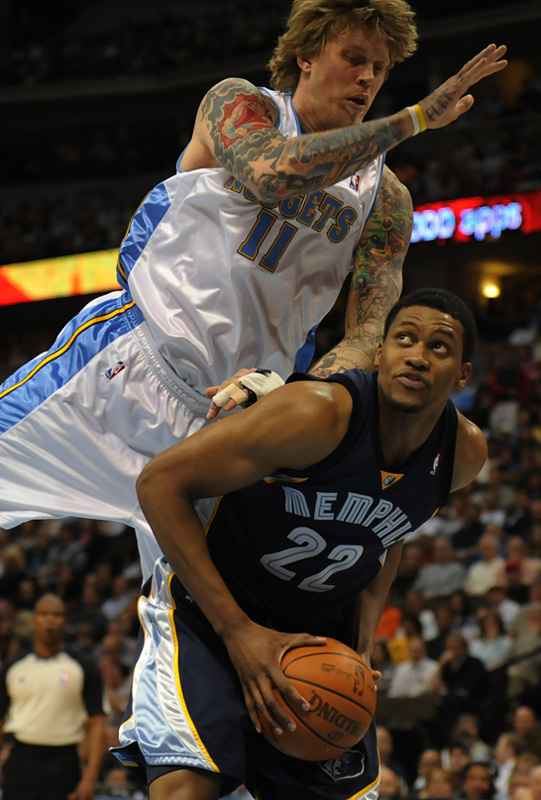 The Denver Nuggets' Chris {quote}Birdman{quote} Andersen, top, flies over the top of the Memphis Grizzlies' Rudy Gay in the first half at the Pepsi Center on Monday 04/12/10.  Photo by Matt McClain