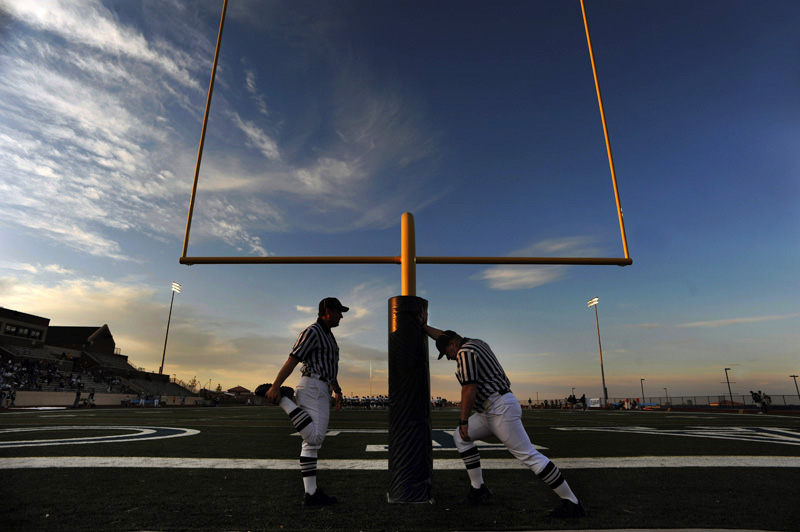 Officials, Ken Beltran, left,  and Bob Chappel, right, stretch prior to the Valor Christian High School and  Conifer High School game Friday 09/18/09 in a 3A matchup at Valor Christian in Highlands Ranch, Colo.  Photo by Matt McClain