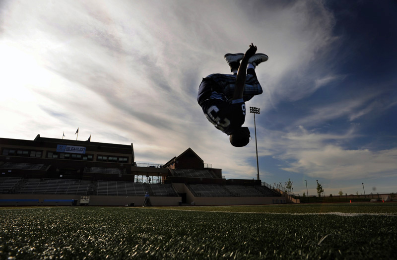 Valor Christian High School's Le-Len Lang does a back flip in the center of the field before his team plays Conifer High School Friday 09/18/09 in a 3A matchup at Valor Christian in Highlands Ranch, Colo.  Photo by Matt McClain
