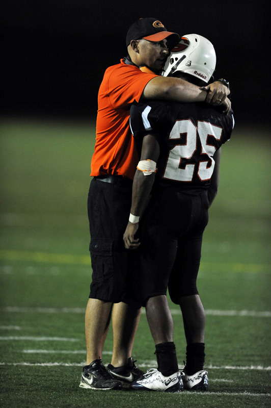 Gateway High School coach, Pat Rock comforts David Anderson after a 41-0 loss to Rangeview High School Friday 09/11/09 at Aurora Public School Stadium.  Photo by Matt McClain