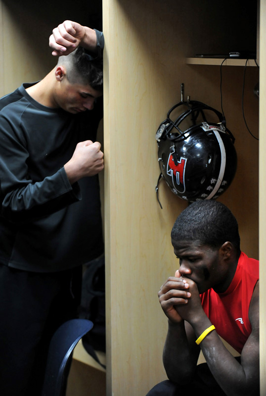 Pomona High School's Tyler Pace, left, and Jamar Herbert show their dejection in the locker room after losing to Mullen in the 5a championship Satuday 12/05/09 at Invesco Field in Denver, Colo.  Mullen won the game. Photo by Matt McClain