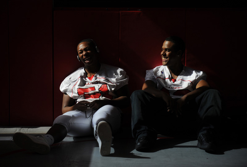 Rangeview High School's Kendrick Rangeview High School's Kendrick Washington, left, and Darian Holmes, right, laugh as they wait for a pre-game coaches talk at their school before traveling on the bus to play Gateway High School  Friday 09/11/09 at Aurora Public School Stadium.  Photo by Matt McClain