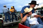 Chad Wiltfang, 22, holds his girlfriend, Brittany Moon, 22, in the back of a pickup truck Thursday August 2, 2007 as they watch cowboys compete during the Carbondale, Colo. Wild West Rodeo Series.  Many locals are concerned that the influx of gas workers may change their way of life.  Photo by Matt McClain
