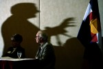 Colorado Governor, Bill Ritter's shadow is seen over County Commissioners as Ritter spoke about the possibility of diverting oil and gas severance tax money.  The surge of natural gas drilling has helped fund many state programs.  Photo by Matt McClain