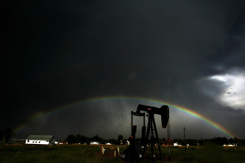 An oil derrick sits in a field as a thunderstorm blows through the town of Dacono, Cclo. Tuesday 8/14/07.  For many the amount of natural gas and oil production in Weld County represents the pot of gold at the end of the rainbow.  Photo by Matt McClain