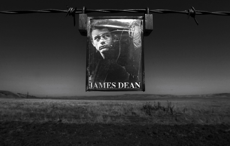 A small photo of James Dean hangs on a barbwire fence close to where his car landed after his car accident on September 30th, 1955.  Dean died of a broken neck after colliding with Cal Poly student, Donald Turnupspeed at the Highway 46 and Highway 41 junction.  Photo by Matt McClain
