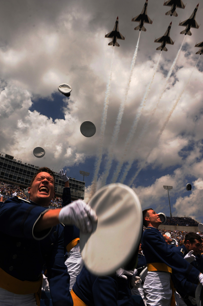 Joel Holley tosses his hat as the Thunderbirds fly overhead at the conclusion of the Air Force Academy graduation ceremony on Tuesday 05/26/10 at Falcon Stadium at the Air Force Academy in Colorado Springs, Colo.  Photo by Matt McClain