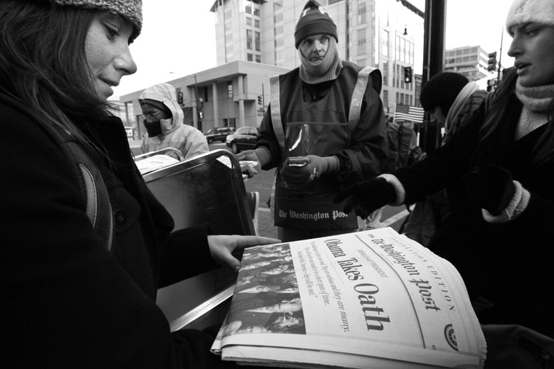 Shouting extra, a vendor sells early editions of the Washington Post  after the Inauguration of President Barack Obama in Washington, D.C.  Photo by Matt McClain