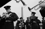 Members of the Virginia Tech cadet marching band rehearse next to the Washington Monument in Washington, D.C.  Photo by Matt McClain