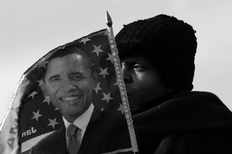 Sharon Thomas holds a Barack Obama flag as she watches the swearing in ceremony on the mall in downtown Washington, D.C.  Photo by Matt McClain
