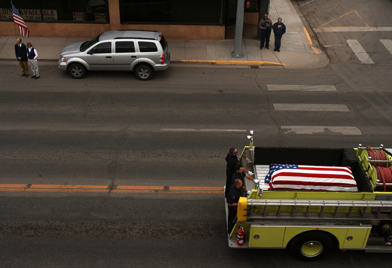 A Monte Vista fire truck carrying the coffin of Srgt. Glen Martinez, 31, drives through the Main St. of Monte Vista, Colo. following the Srgt.'s funeral.  Photo by Matt McClain