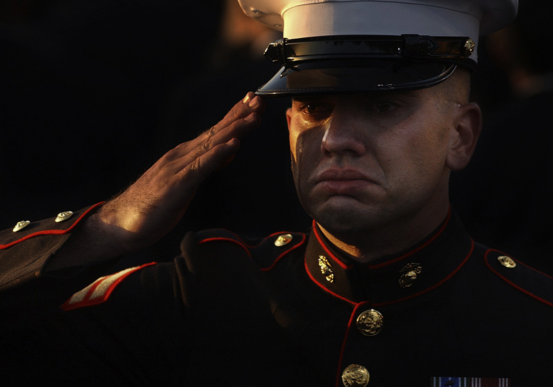 Srgt. Ethan E. Rocke of the Marine Corps Recruit Depot in San Diego cries while he salutes Ronald Reagan as taps is played at the burial ceremony for the 40th President of the United States at his library in Simi Valley, Calif.  Photo by Matt McClain