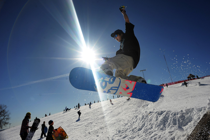 Matt Jiang, 16, makes a jump off a bank of snow after riding the new rails for snowboarders at Ruby Hill Park in Denver, Colo. on 01/09/10.  The rail course is free to the public.  Photo by Matt McClain