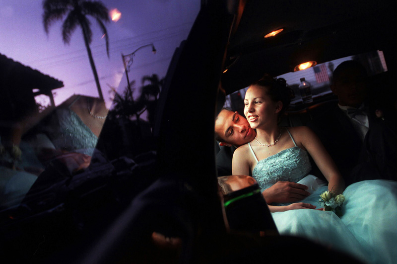 Jennifer Hillman , 17, rides in a limousine with her prom date, Andres Moraza, 17,  on their way to Gisella's Italian Restaurant in Santa Barbara, Calif. before attending their Ventura High School prom.  Photo by Matt McClain