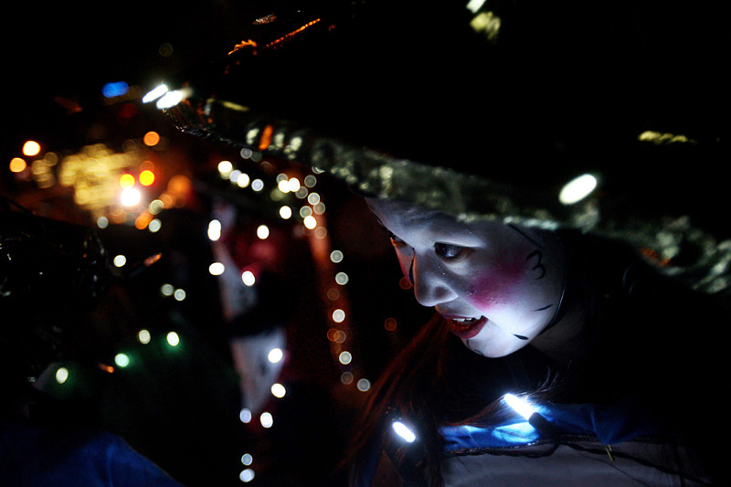 Michelle Park, 17, dressed as lighted clocks and took part in the 9 News Parade of Lights in Denver, Colo.  Photo by Matt McClain