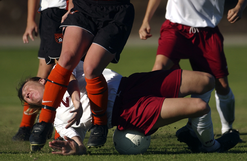 Mt. San Antonio College's Nikki Huber gets  tripped up and trompled by Ventura College's Shelly Dipaolo and others in the first half of Ventura's overtime victory at Ventura College. Photo by Matt McClain