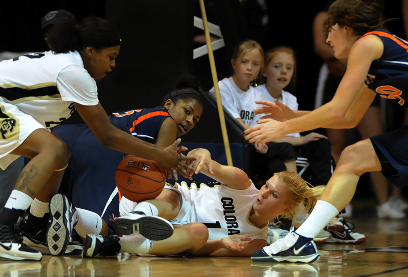 University of Colorado women's basketball team's Brittany Spears, left, tries to grab the ball from teammate, Alyssa Fressle after she stole the ball from Paulisha Kellum of  the University of Virginia Saturday 01/02/10 at the Coors Event Center in Boulder, Colo.  Virginia came into the game ranked in the top 25.  Photo by Matt McClain