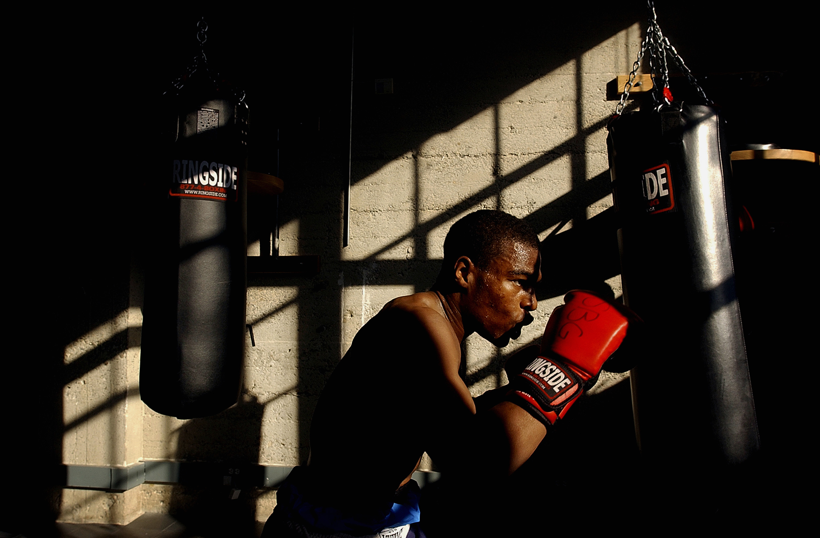 US Navy National team member, Mylin Wyche, 24, of Naval Base Ventura County works out on a heavy bag at Sylva's Boxing Gym in Ventura, Colo.  Photo by Matt McClain