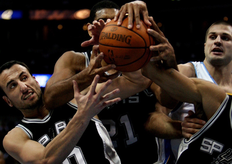 Manu Ginobili, left, and a host of San Antonio Spurs go for a rebound as Denver Nuggets, Linas Kleiza, right, looks on at the Pepsi Center in downtown Denver, Colo.  Photo by Matt McClain