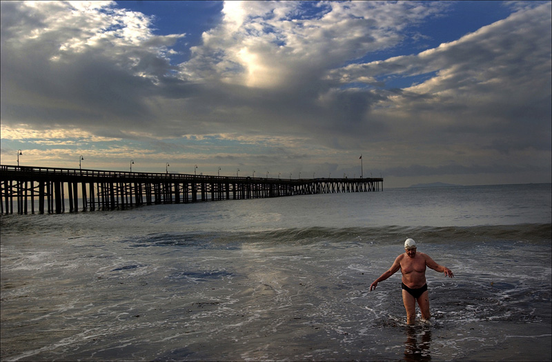 Guy Cooper, 74, of Ventura, Calif. climbs out of the water after swimming around the Ventura pier as the sun rises. Cooper along with a handful of others make the swim each morning.  Photo by Matt McClain
