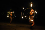 Rosemary Cornelius, left, and Lydia Russell, right, take part in a practice with the group, Revolutionary Motion at Old City Farm and Guild on Thursday August 11, 2016 in Washington, DC. The group is preparing to perform a fire based routine at Burning Man in Nevada. (Photo by Matt McClain/ The Washington Post)