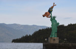 Jacob Clad, 22, flips into Lake Pend Oreille from a replica of the Statue of Liberty on Wednesday June 22, 2016 in Sandpoint, ID. (Photo by Matt McClain/ The Washington Post)