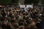 People gather during a community vigil at the Aurora Municipal Center that included victims families among the thousands that turned out on Sunday July 22, 2012 in Aurora, CO.  The event was to honor the memories of those injured and killed in the deadly shooting Friday morning at the Century Aurora 16 that left twelve dead.