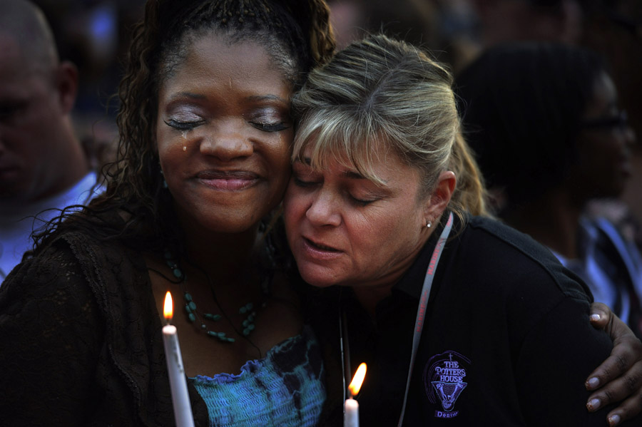 Titia Stillwell embraces Lori Meade, both of Aurora, as thousands turned out for a community vigil at the Aurora Municipal Center that included victims families on Sunday July 22, 2012 in Aurora, CO.  The event was to honor the memories of those injured and killed in the deadly shooting Friday morning at the Century Aurora 16 that left twelve dead.