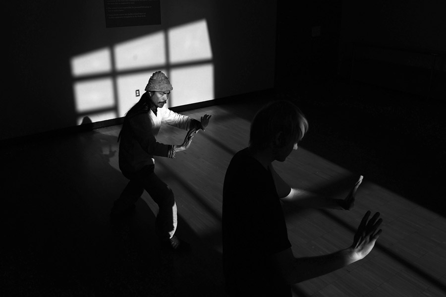 Mamerto Tindongan, left, helps instruct Tai Chi as Ben Piper takes part in the class taught at Athens Community Center on Saturday April 11, 2015 in Athens, OH. (Photo by Matt McClain/ The Washington Post)