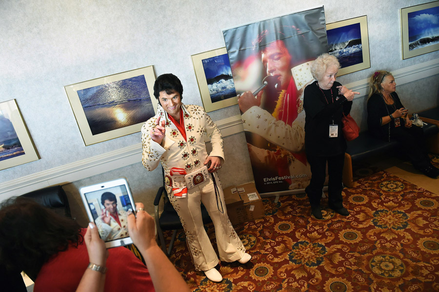 Elvis tribute artist, David King, 42, of Greencastle, PA poses for a photograph after performing at the Ocean City Elvis Festival which took place at the Clarion Resort Fontainebleau Hotel on Friday October 23, 2015 in Ocean City, MD. King is a church pastor.
