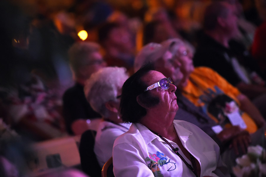 Dressed for the occasion, Jean-Pierre Bouvier watches an Elvis tribute artist perform during the Ocean City Elvis Festival at the Clarion Resort Fontainebleau Hotel on Saturday October 24, 2015 in Ocean City, MD. Originally from Fance, Bouvier has a large Elvis collection.